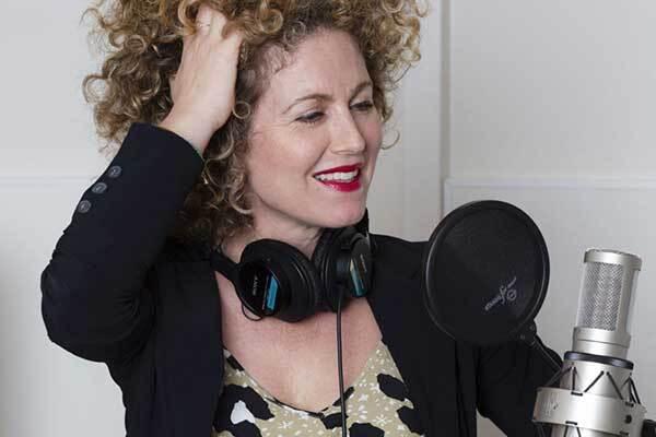 Dutch female voice-over talent in studio.