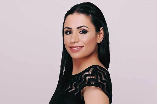 Female Jordanian voice-over talent in studio.