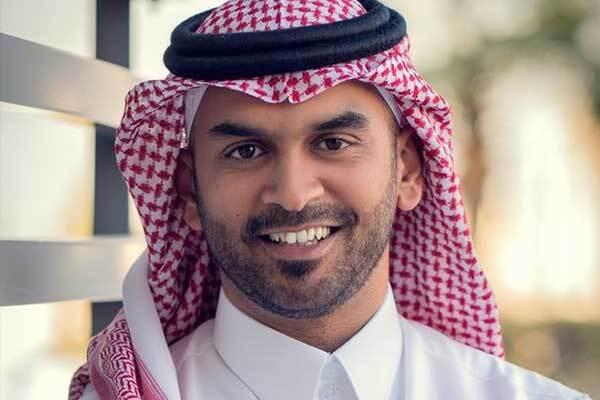 Saudi male voice-over talent smiles outside studio.