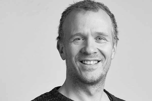 Norwegian male voice-over talent , smiling, black & white.
