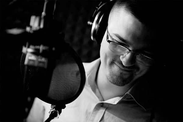 Polish male voice-over talent in home studio. Black & White.