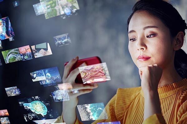 Pretty Chinese woman watches web video with Chinese subtitles.