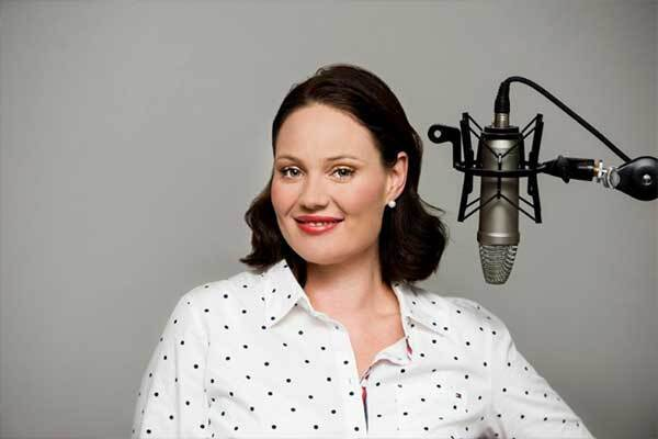 Australian voice-over talent, with red lipstick and dark hair, gets ready to record.