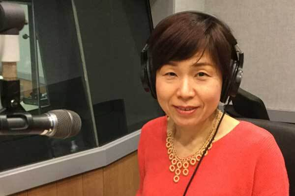 Mature Japanese Female Voice-Over Talent sits in Tokyo studio ready to record.